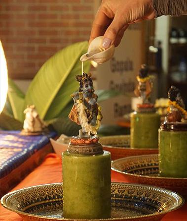 Bathing Krishna deity krishnas birthday adelaide festival janmashtami